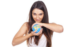 Woman holding a globe in hands Stock Photography