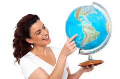 Woman holding globe in her hand Royalty Free Stock Images