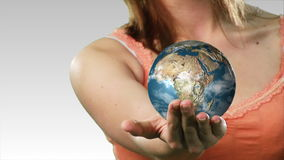 Woman Holding a Globe in her hand Stock Photo