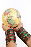Woman holding globe on her hands Royalty Free Stock Image