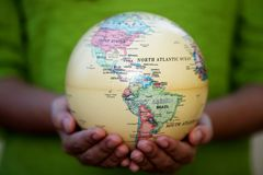 Woman holding globe on her hands Stock Photos