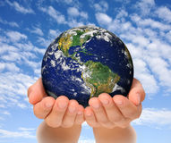Woman holding globe on her hands, South and North  Stock Image