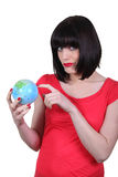 Woman holding a globe Royalty Free Stock Photos