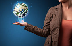 Woman holding glowing earth globe Royalty Free Stock Photos