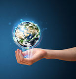 Woman holding a glowing earth globe Royalty Free Stock Photo