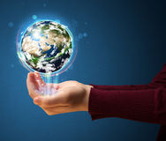 Woman holding a glowing earth globe Royalty Free Stock Images