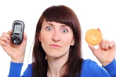 Woman holding glucose meter and cake Royalty Free Stock Photo