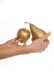 Woman holding a gold apple and pear Royalty Free Stock Photo