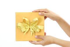 Woman holding a gold gift box Stock Image