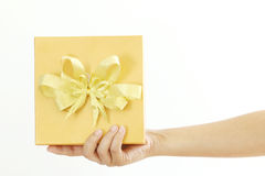 Woman holding a gold gift box Royalty Free Stock Image