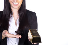 Woman holding gold ingot Royalty Free Stock Photo
