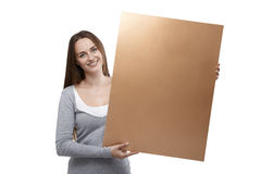 Woman holding golden billboard Royalty Free Stock Photography