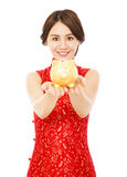 Woman holding a golden piggy bank . happy chinese new year Royalty Free Stock Image