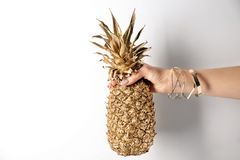 Woman holding golden pineapple royalty free stock images