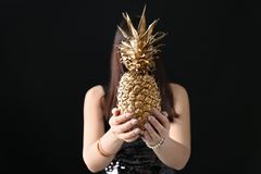 Woman holding golden pineapple royalty free stock photos