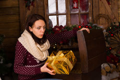 Woman Holding Golden Presents from Wooden Trunk Stock Photography