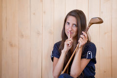 Woman holding golf stick Stock Photo