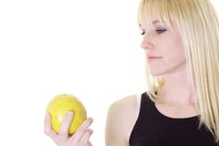 Woman holding a grapefruit Royalty Free Stock Photography