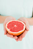 Woman holding grapefruit Royalty Free Stock Image