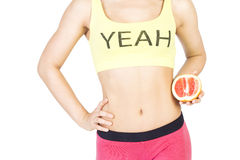 Woman holding a grapefruit next to the waist. Diet and proper nu Stock Photos