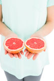 Woman holding grapefruit slices Stock Photography
