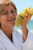 Woman holding grapes Royalty Free Stock Photo