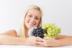 Woman holding grapes Royalty Free Stock Photos