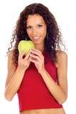 Woman holding greeen apple. Curl hair brunette woman holding greeen apple, isolated Stock Photo