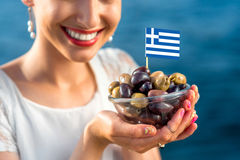 Woman holding greek olives Royalty Free Stock Image