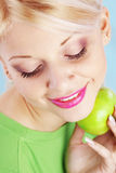 Woman holding green apple Stock Photo