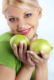 Woman holding green apple royalty free stock photography
