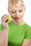 Woman holding green apple Royalty Free Stock Images