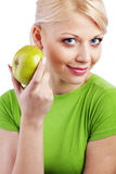 Woman holding green apple Royalty Free Stock Photos