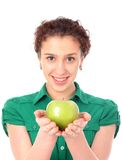 Woman holding green apple Royalty Free Stock Image