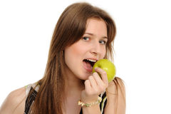 Woman holding a  green apple Royalty Free Stock Images