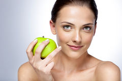 Woman holding green apple Stock Photos