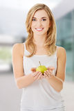 Woman holding a green apple Stock Photos