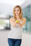 Woman holding a green apple Stock Photography