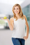 Woman holding a green apple Royalty Free Stock Photo