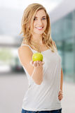 Woman holding a green apple Royalty Free Stock Photography