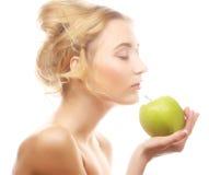Woman holding green apple Stock Photo