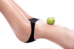 Woman holding a green apple on her belly Stock Photography