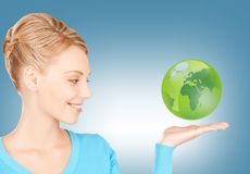 Woman holding green globe on her hand Stock Photos