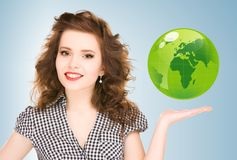 Woman holding green globe on her hand Stock Photography