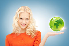 Woman holding green globe on her hand Stock Photo