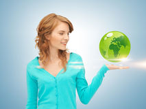 Woman holding green globe on her hand Stock Image