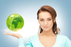 Woman holding green globe on her hand Royalty Free Stock Photos
