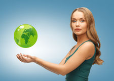 Woman holding green globe on her hands Royalty Free Stock Photos