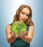 Woman holding green globe on her hands Royalty Free Stock Images