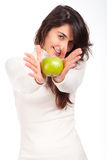 Woman holding a green happy between hands and smiling Royalty Free Stock Photography